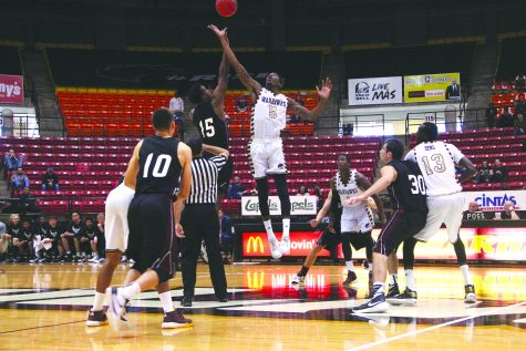 Men's basketball team bounces into history