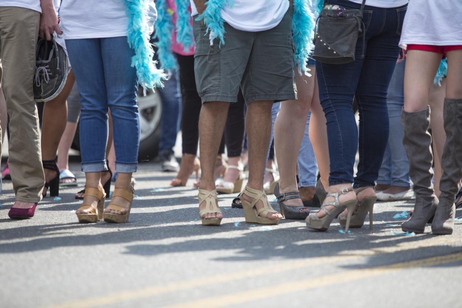 Male+and+female+students+strut+their+heels+in+this+year%27s+Walk+a+Mile+in+Her+Shoes+sexual+abuse+awareness+walk.+Photo+by+Siddharth+Gaulee.