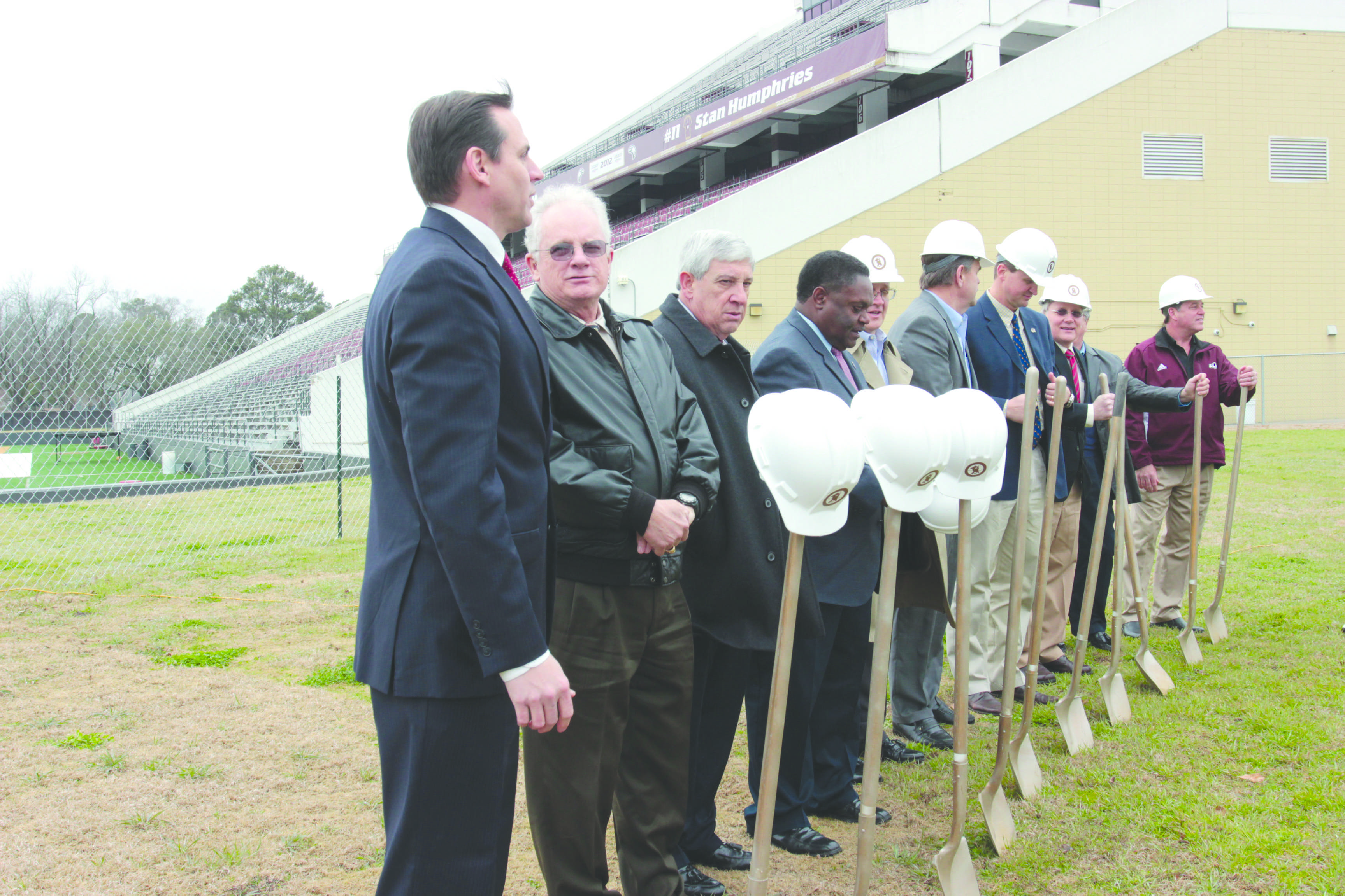 Athletic director Brian Wickstrom, university president Nick Bruno, Monroe mayor Jamie Mayo, head football coach Todd Berry , and others break ground Monday.   photo by Joshua Detiege