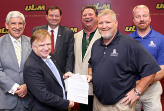 Brayton (second from the left) receiving the $85,600 donation from the Louisiana Contractor's Education Trust Fund.