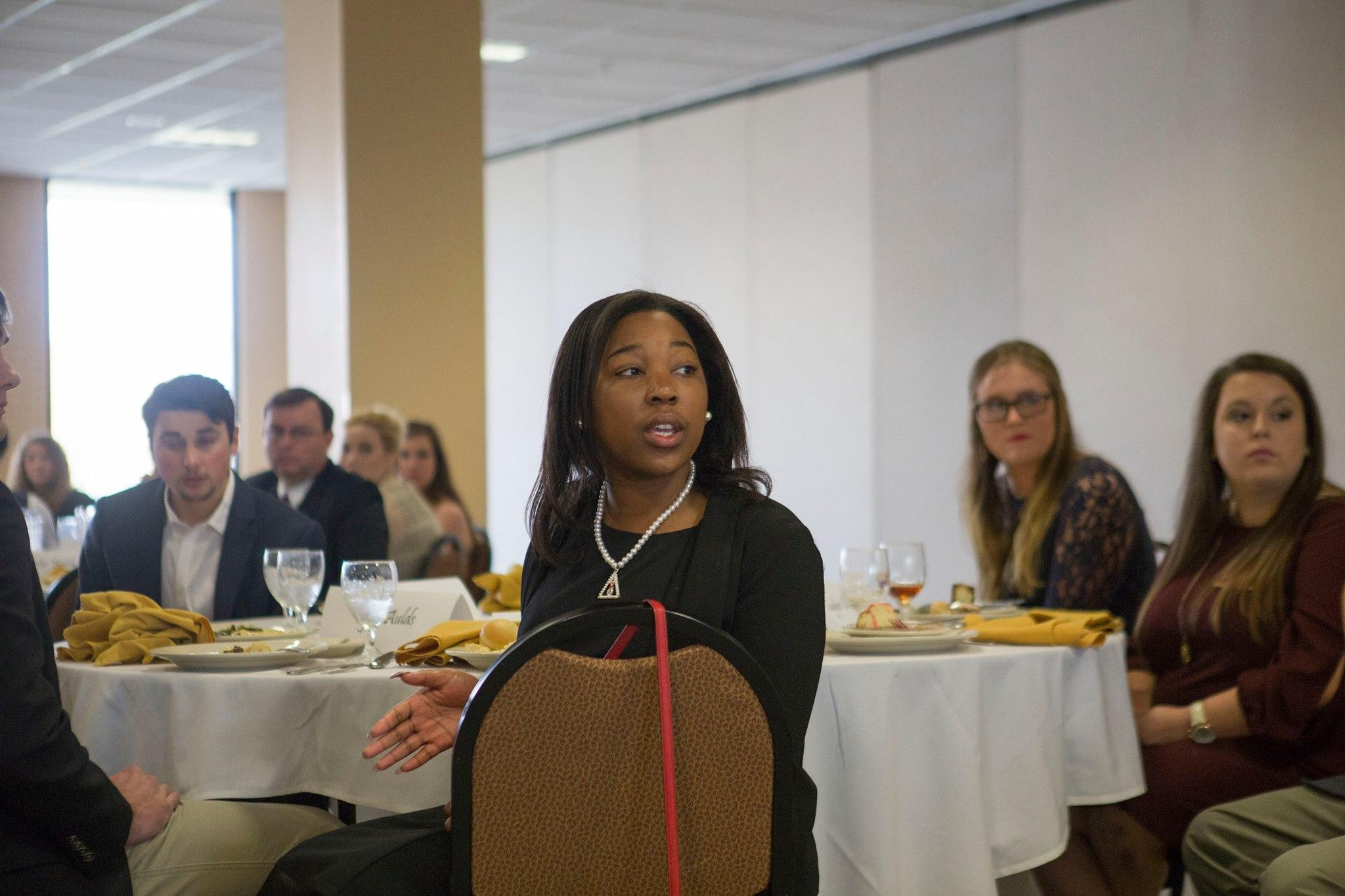 Bria Mays listens to the questions and remarks made at the luncheon.