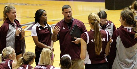 Coach Hiltz talks over his adjustments during a timeout with his team last season.