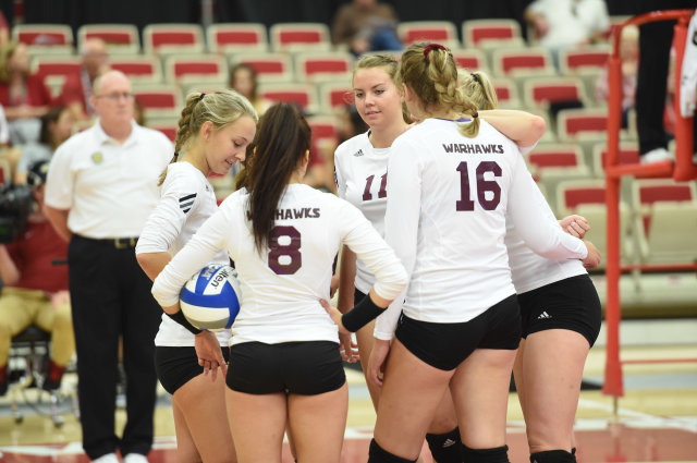 The team huddles during a match in Arkansas.