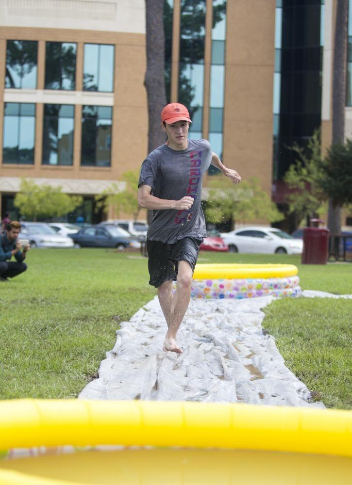 Slippery Tracks: Student tries to balance himself on the tarp.