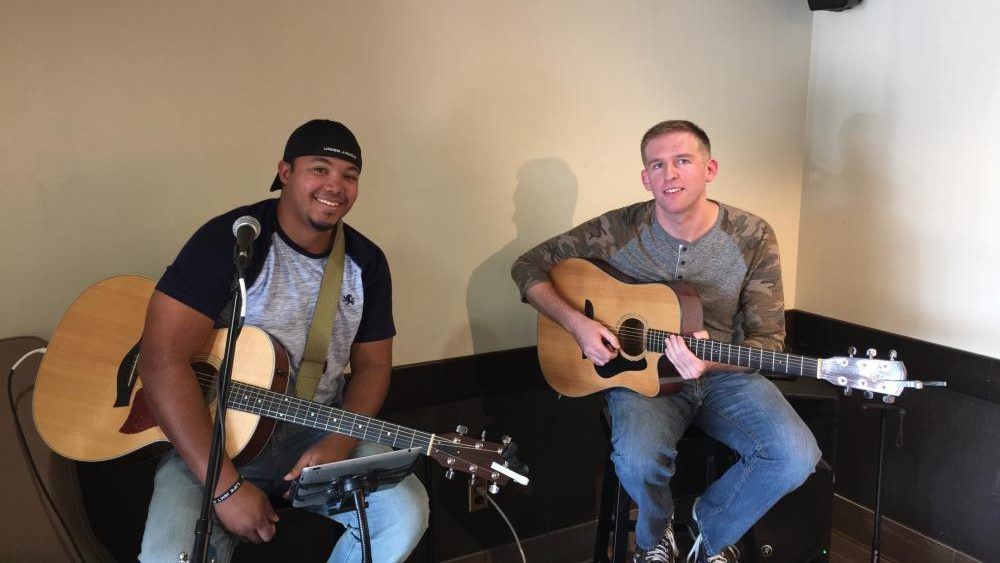 COFFEE MELODY: Presley and McConkey provide live music in Starbucks last Thursday.