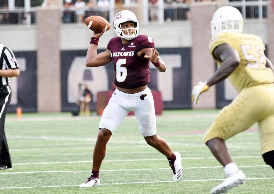 PASS+IT%3A+Caleb+Evans+thows+a+past+in+football%E2%80%99s+game+against+Texas+State+on+Saturday.