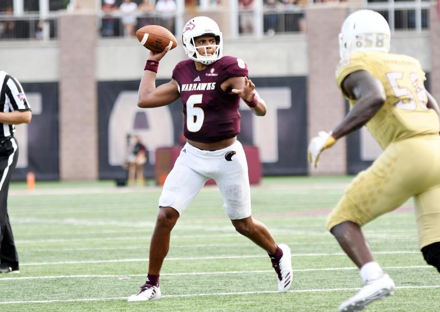 PASS IT: Caleb Evans thows a past in football's game against Texas State on Saturday.