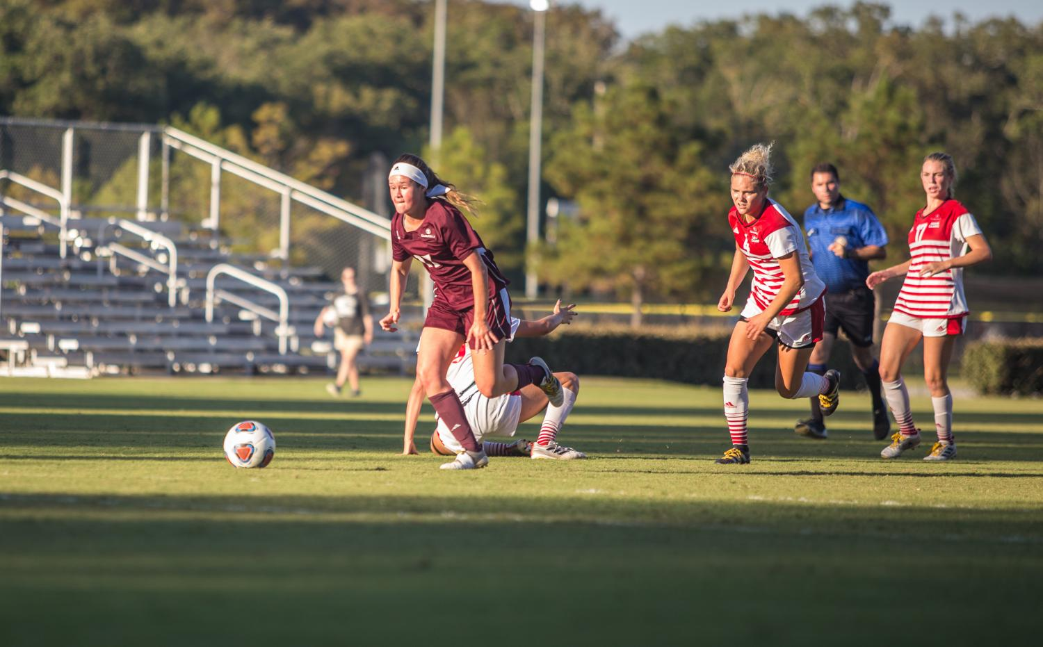 WORK THOSE CLEATS: Taylor Altieri runs down the field in soccer's game against ULL.