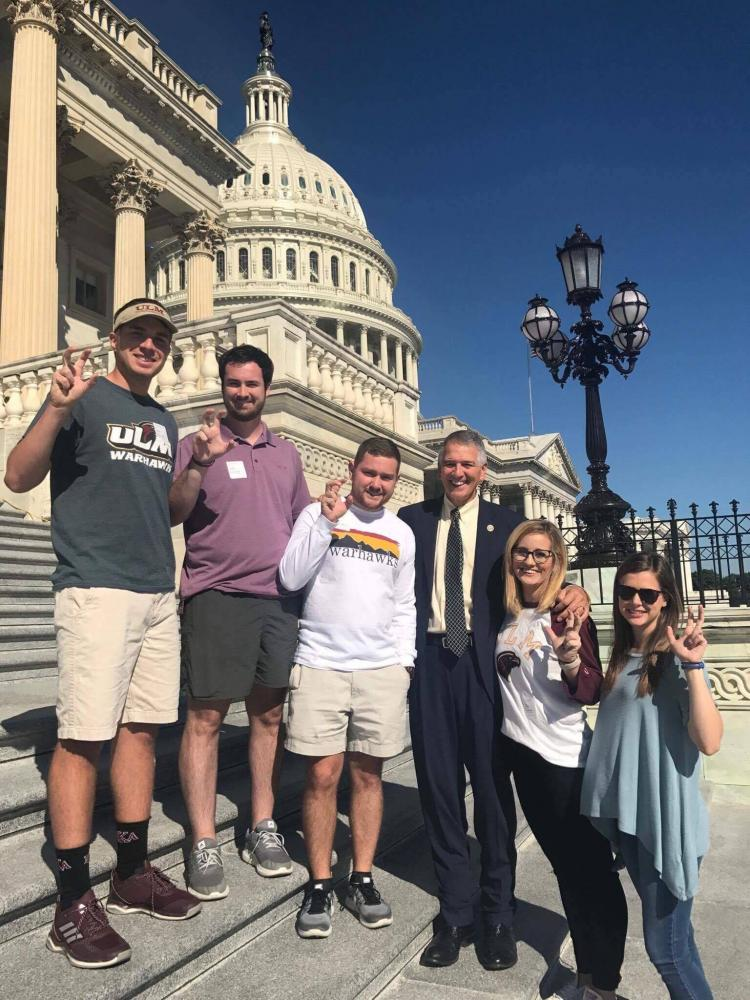 TALONS OUT IN D.C.: SGA officers posing with their talons out in a photo with Representative Ralph Abraham.