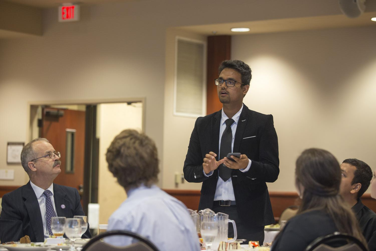LET'S TALK: SGA Senator Sachin Thapa asks a question during Lunch with the President last week.
