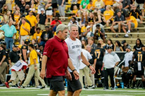 Pederson, Favre meet for cointoss