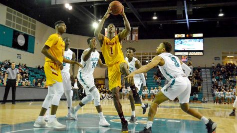Men's basketball notches close win