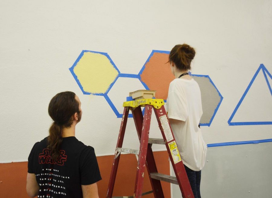 Community unites to paint, uplift local homeless shelter