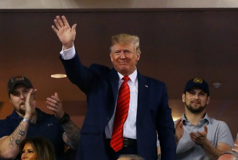 U.S. President Donald Trump acknowledges the crowd during Game 5 of the 2019 World Series between the Houston Astros and the Washington Nationals on Sunday, Oct. 27, 2019 at Nationals Park in Washington, D.C. (Alex Trautwig/MLB Photos via Getty Images/TNS)