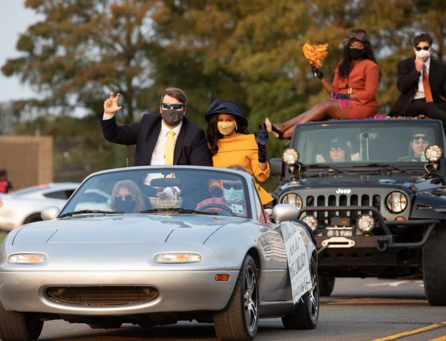 Homecoming court parades in style
