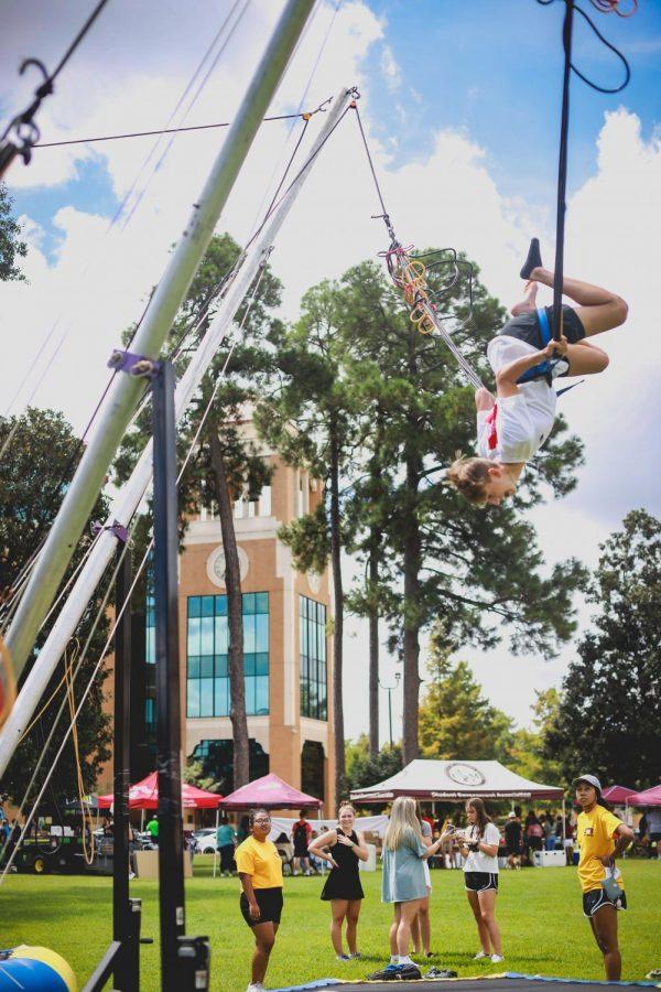 Students enjoy free food, games in back-to-school festivities