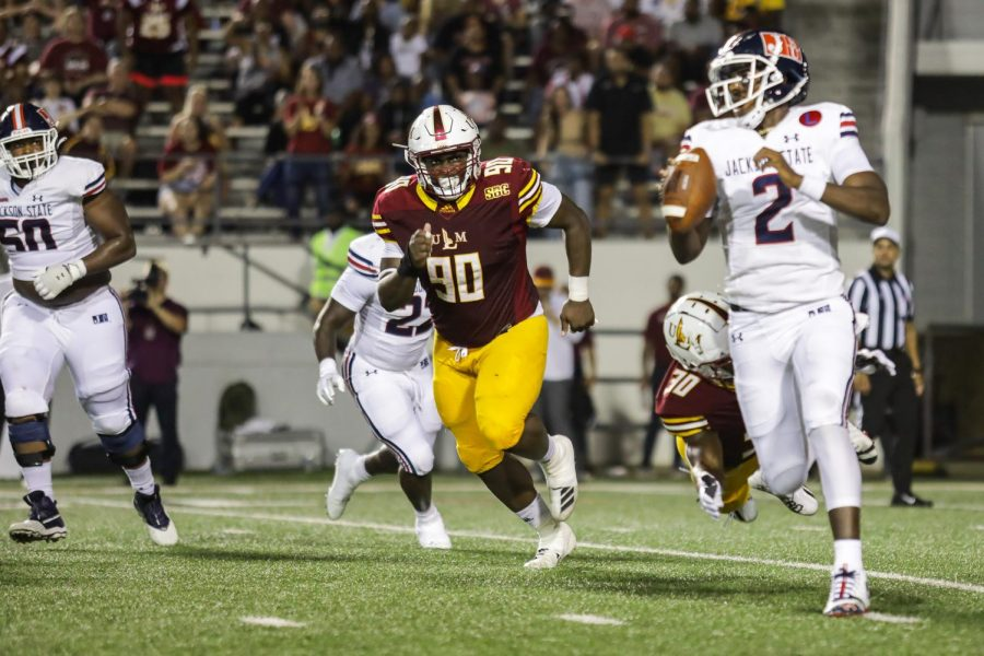 Malone sweet home: Defense shines in home opener